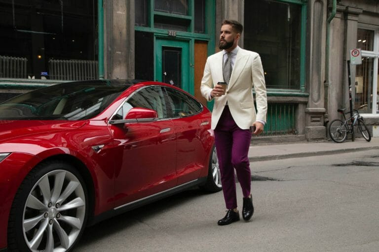 Man holding coffee next to car,car shippers