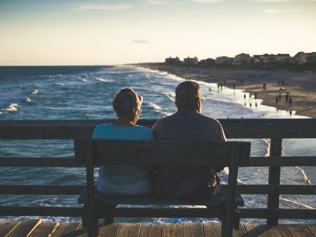 snowbird / elderly couple looking out into the seashore_ snowbird car shipping